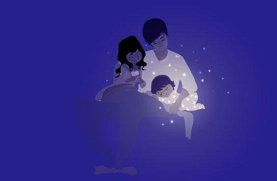 Disegno di mamma, papà e bimbo che dorme tra le loro braccia