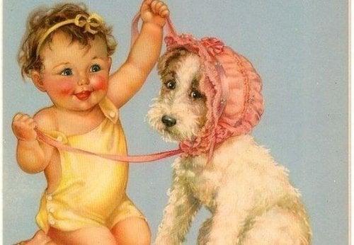 Bambina che mette la cuffia al cane