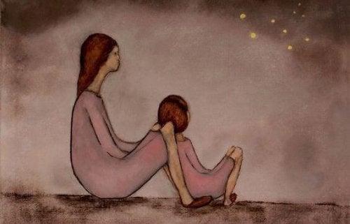 Mamma e figlia che guardano le stelle