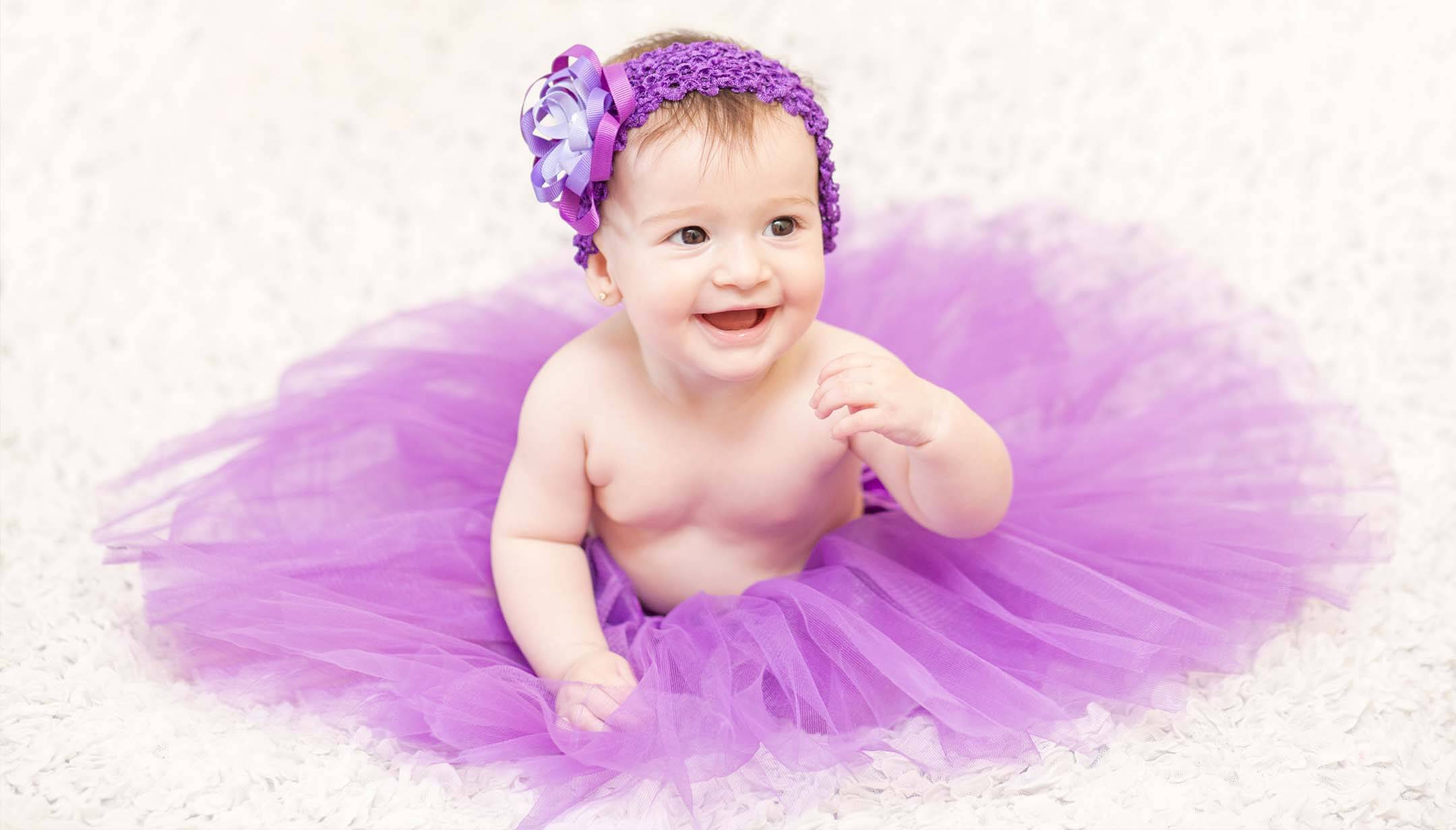 Nel fare foto artistiche al bebè, è importante farlo risaltare sullo sfondo