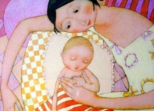 Mamma dorme con il suo bambino perché sia staccato dalla paura