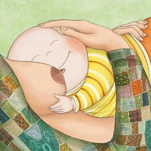 Bambino dorme in braccio della mamma