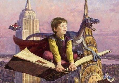 bambino che vola sopra ad un libro con drago