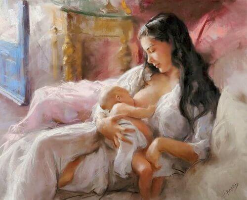 Donna dà il petto a neonato