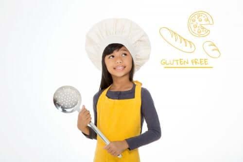 bambina vestita da cuoco con malattia celiaca