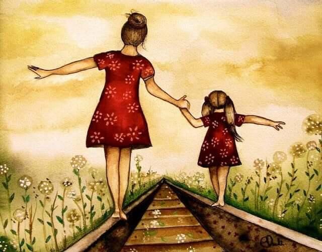Madre e figlia per mano sulle rotaie del treno.