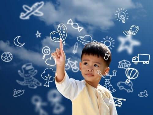 Bambino e simboli di espressione creativa.